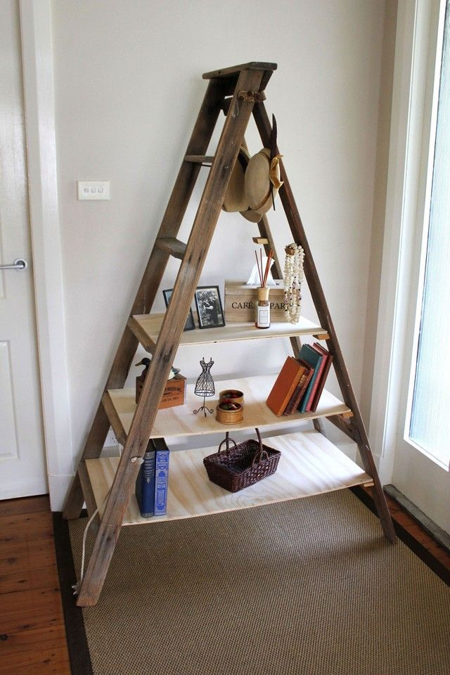 Charming Wooden Ladder Bookshelf On Wooden Floor Plus Tan Carpet Mathced With White Wall For Living Room Decor Ideas