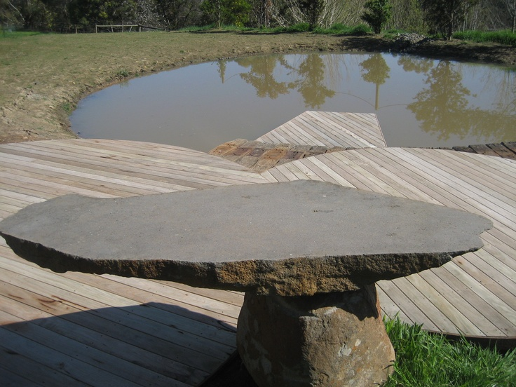 Radial sawn timber decks and recycled railway sleeper jetty. Huntly Barton stone table.