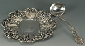 """Two pieces in Reed and Barton's Francis I pattern. 1st item: Sterling silver tray or sandwich platter, round with shaped sizes and cast fruit and floral decoration, marked on base Reed & Barton Francis I x569 Sterling, 11-1/8"""" diameter, 17.64 oz troy. 2nd item: Soup ladle with oval bowl, old Reed and Barton mark with patent date of '07 on back, 11""""L, 8.01 oz troy. Provenance: the estate of Sara Lee Buhler, Yorktown, Indiana."""
