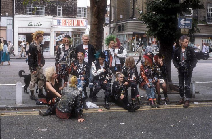 https://flic.kr/p/JjKVqZ | Punks on the Kings Road, London, 1983 | Malcolm McLaren and Vivienne Westwood's shop at 430 Kings Road, Chelsea opened in 1971 as 'Let it Rock.' To begin with it sold original fifties clothing, but they soon started to create their own brighter and more extravagant copies to sell. By 1974 the name of the shop had been changed to 'Sex' and while still selling some Teddy Boy gear it came to predominantly sell fetish, PVC, leather and rubber gear and introducing…