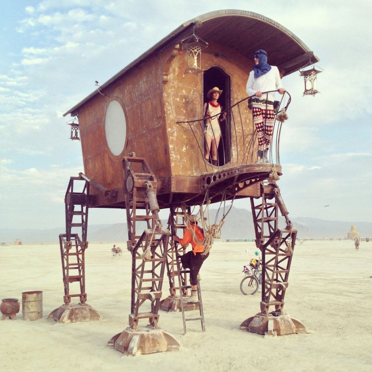 Lost Nomads of Vulcania: The Teluriz. This steampunk inspired walker was designed and crafted in studio in Eugene, Oregon. Here's a shot of it installed at Burning Man 2014.