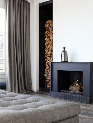 a tailored contemporary fireplace with wood storage fireplace
