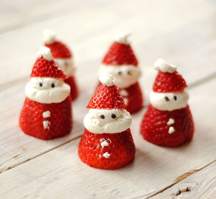 Strawberry Santas--cut strawberries and fill w whipped heavy cream and a little powdered sugar. Use Chocolate sprinkles for eyes.