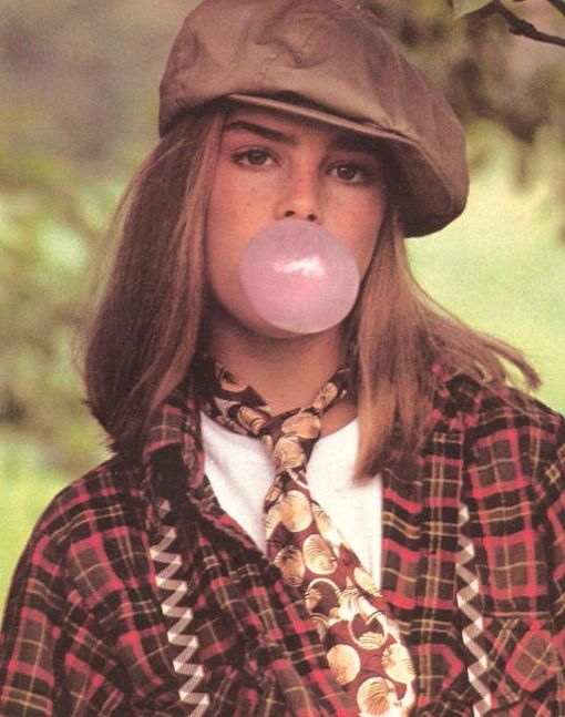 Young brooke shields in newsboy cap
