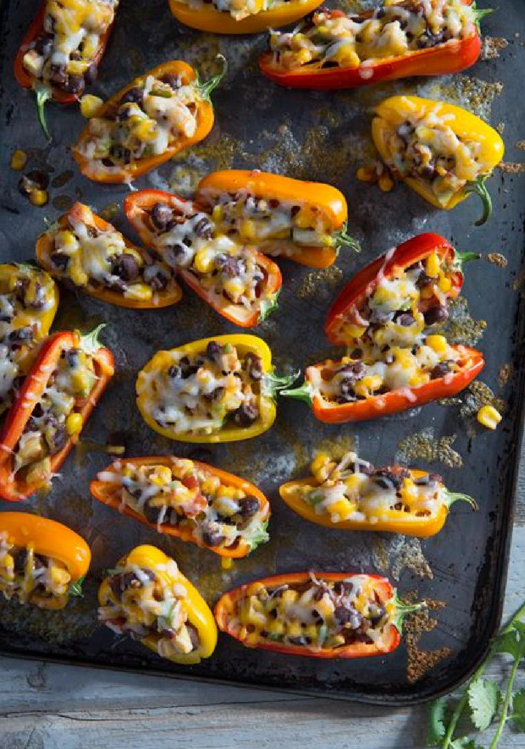 Sweet Mini Bell Pepper Poppers – Stuffed with a flavorful mixture of avocados, beans, corn, and salsa, this mini pepper popper appetizer recipe makes a fine addition to any party buffet.