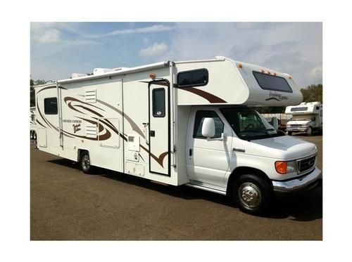 2008, Coachmen Freedom Express  New tires (5200 miles) Ford E450 chassis Leather seats in cab 2 slides, living room (slide topper) & kitchen New Patio awning Master bedroom has Queen bed - See more at: http://www.rvregistry.com/used-rv/1004162.htm#sthash.uW4DNcdD.dpuf
