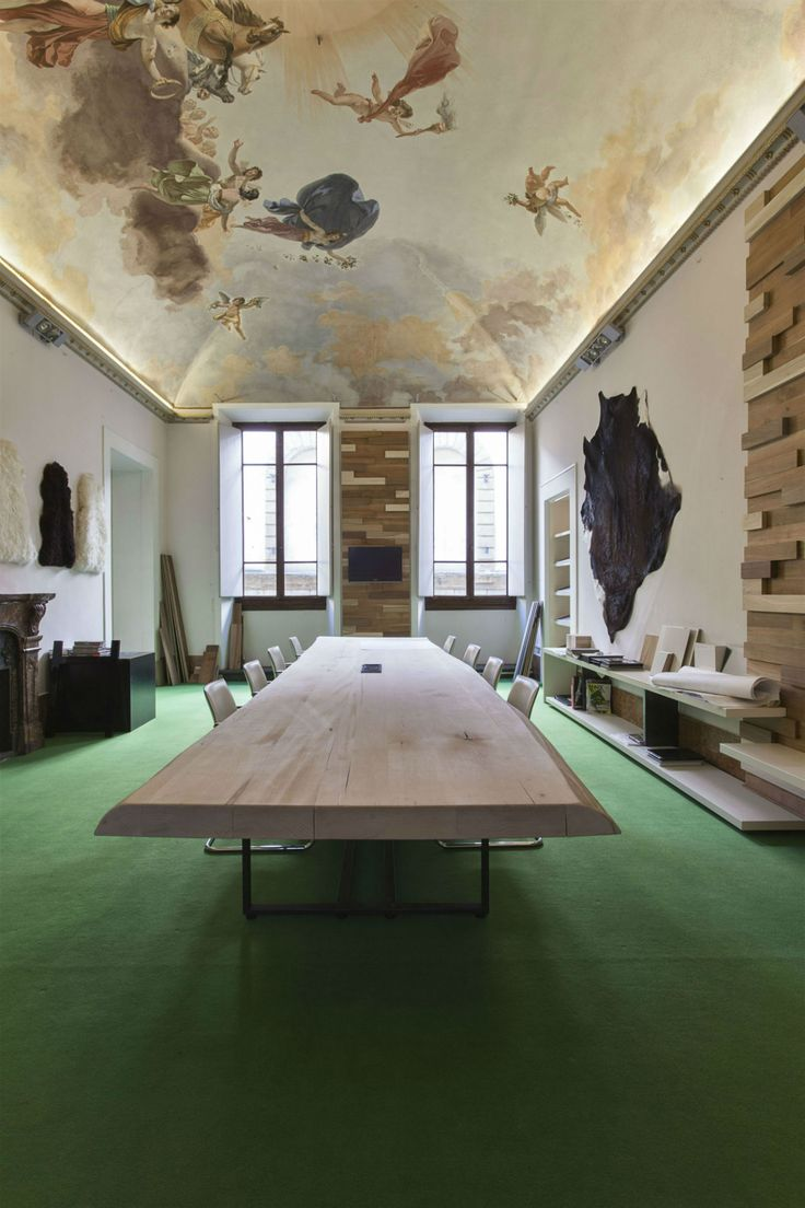 In the main meeting room, the vaulted ceiling of which is completely frescoed, a very long solid table and a marble fireplace create a comfortable, warm environment in which to receive guests #interdema #designstudio #moderndesign #GiraldiAssociati #StudioGAA #современныйдизайн