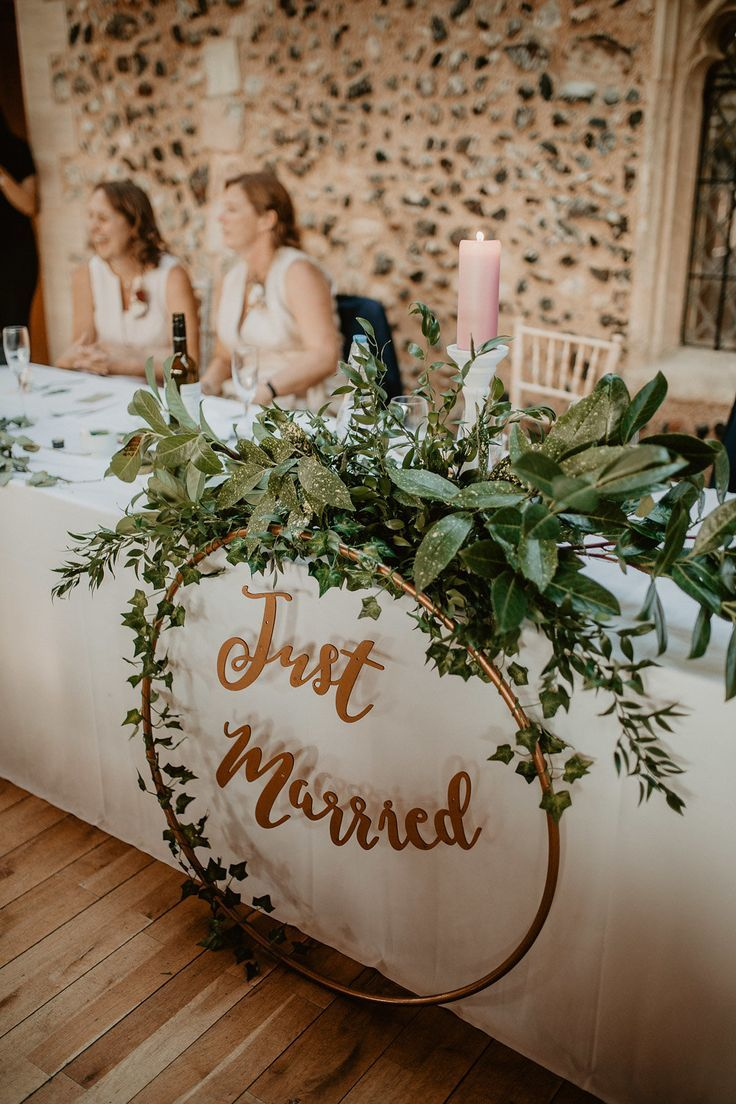 Norwich Cathedral Wedding Contemporary and atmospheric with Perspex Signage & Greenery wedding table