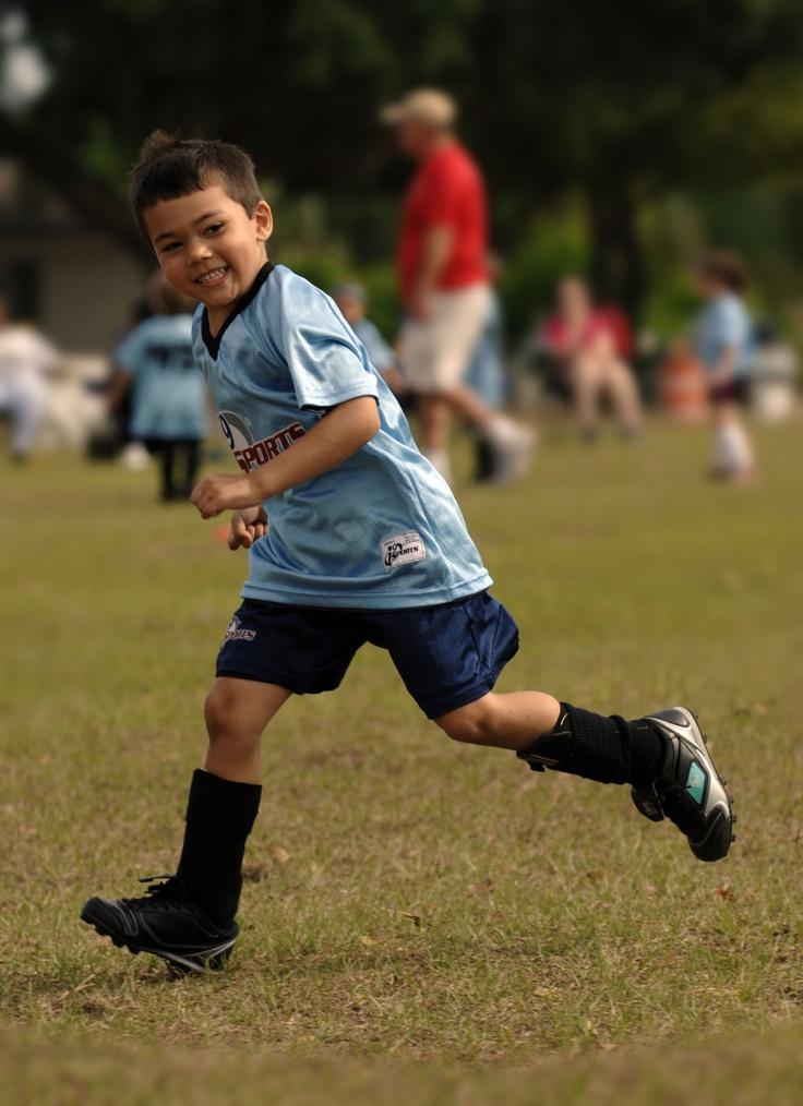 i9Sports Happy boy enjoying a Saturday soccer game. We