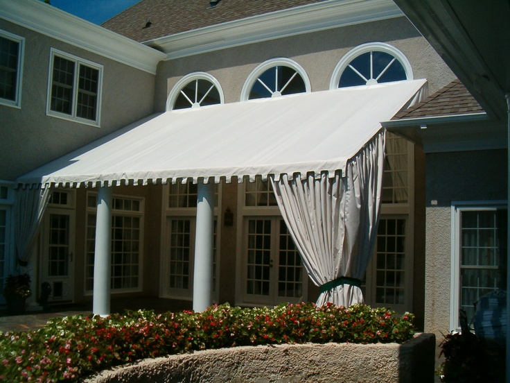 Stationary Patio Awning W/ Greek Key Valance And Accent Curtains On LKN. By  Alpha Canvas U0026 Awning.