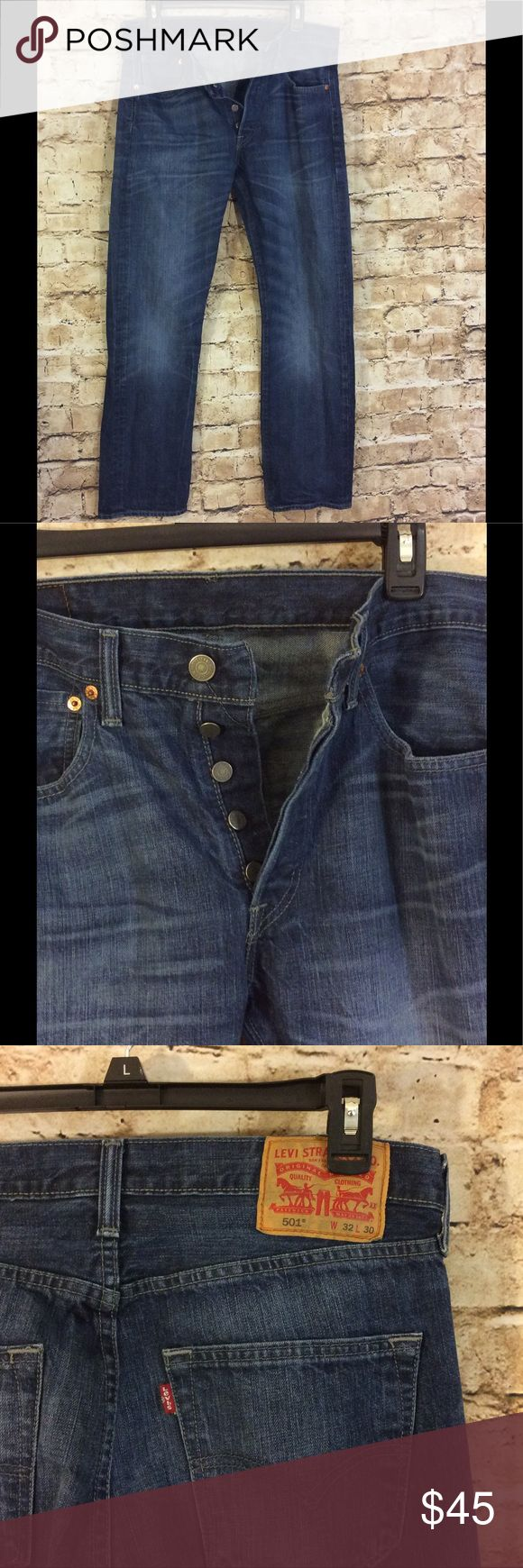Levi Strauss 501 button fly jeans 100% cotton Levi Strauss and Company 501 button fly dark wash jeans Waist 32 length 29 Rise is 11 inches Boot cut New condition Levi's Jeans Boot Cut