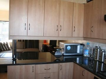 This 2 bedroom flat is situated about 3kms from the university, and about 1km from the Spur. This is ideal for either younger working couples or students. Call today to make an appointment.