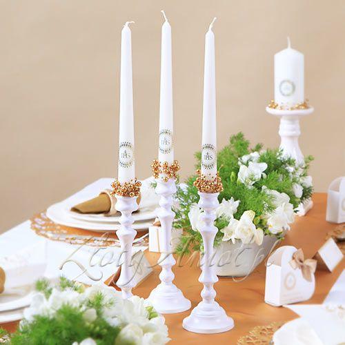 Świece z komunijną aplikacją z Hostią będą piękną i elegancką dekoracją stołu na Komunię.