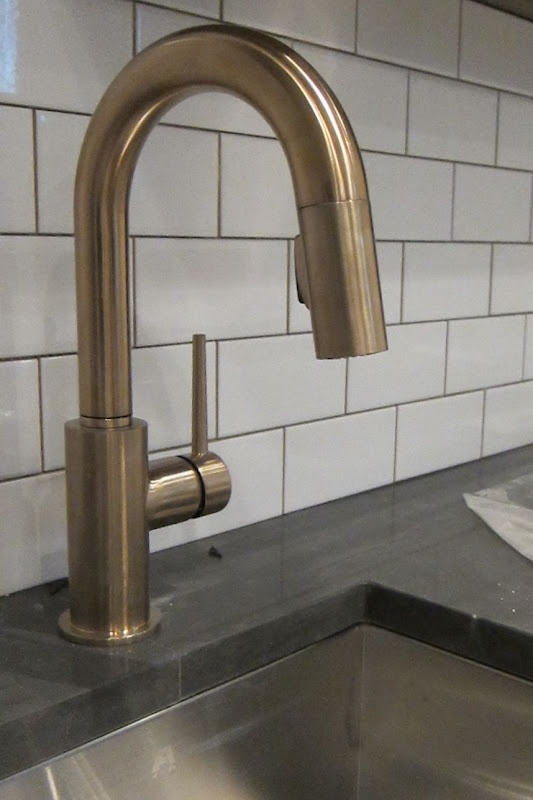 aged brass tap, metro tiles and grey grout. How many trends in one place?