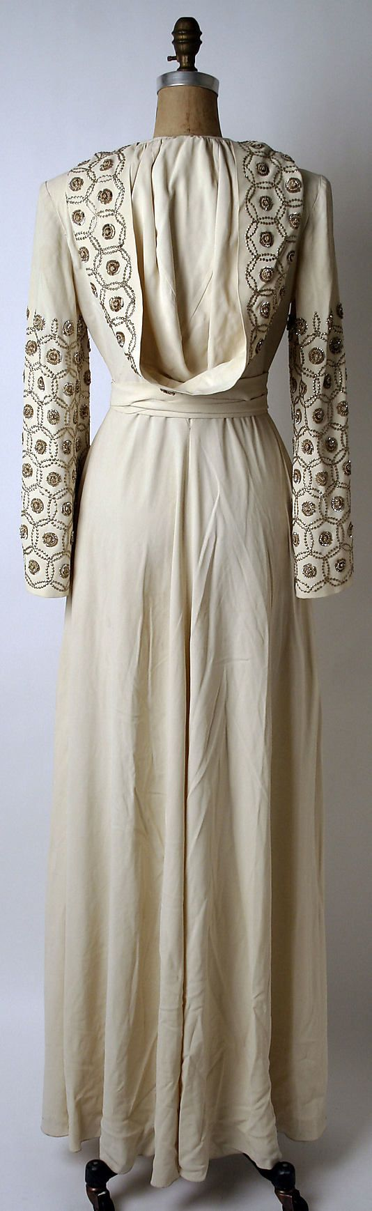 Wedding dress, Norman Norell (1942). Embroidered sleeves and hood