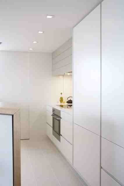 Kitchen with hidden appliance cupboard. Brooke Aitken Design.