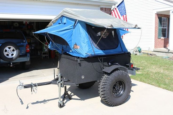 Off road trailer Tent Topped with a compact Ayer model tent unit