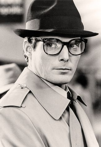 Clark Kent Superman: Trench Coat, Fedora Hat, Square Frames, Superman Costume underneath, of course.