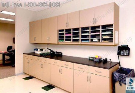 Work room - Like top and bottom cabinets. Also like that bottom has drawers & cabinets