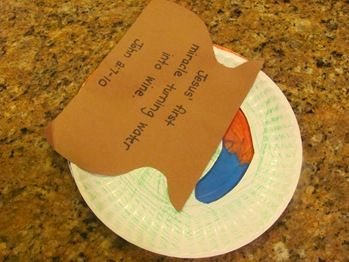 Water to Wine  Craft from Kathy Ross; she has several good books available.  Take 2 paper plates and cut out a curved section from one. Have child color 1/2 of the plate blue & the other 1/2 red. They can color the with the cut out however they wish. Put this plate on top of the red and blue plate and attach them w/a paper fastener.   Glue a brown jug cut from construction paper on one side of the plate so that it looks like the water is turning into wine as you turn the bottom plate.