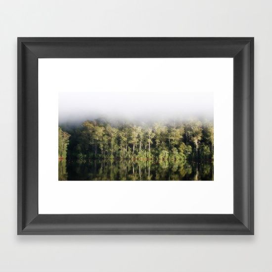 A tree lined lake on a foggy winter's Day Framed Art Print
