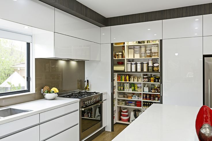 The pantry in this stunning contemporary kitchen sits behind custom built frosted glass sliding doors and provides an abundance of organised storage solutions guaranteeing a clutter free kitchen.
