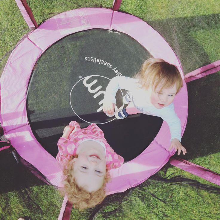 Girls on their Plum trampoline, amazing fun in the Spring sun