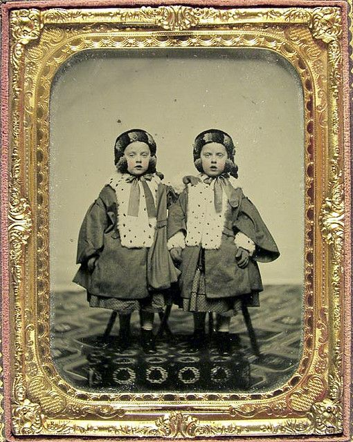 ::::::::: Antique Photograph ::::::::: Portrait of twin girls from the Watts family, dressed in identical fur-lined outfits.