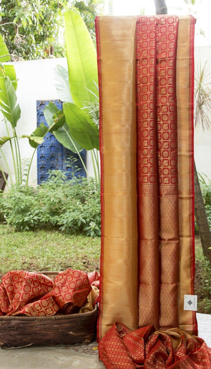 This kanchivaram silk has traditional kanchi motifs woven in gold zari over a crimson red base. The pallu weave is even more intricate and detailed while the border is a simpler gold band making it...