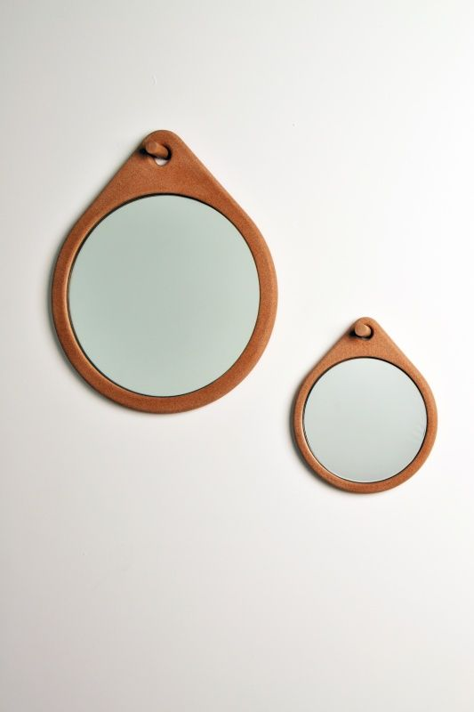Laquered Cork Mirrors by Daniel Schofield Studio. The design was conceived to stand the test of time by incorporating high quality materials through precise manufacturing.