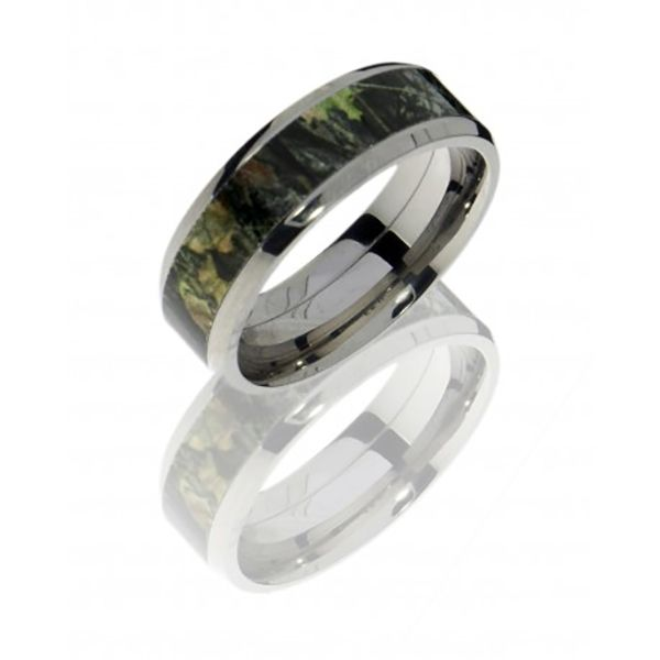 Strong but light weight, this Titanium band features a subtle nature pattern.  Lashbrook Designs