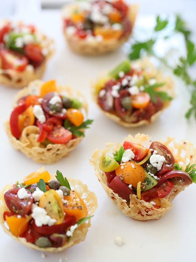 Fill Parmesan cups with heirloom tomatoes, red peppers, and goat cheese to make this appetizer.