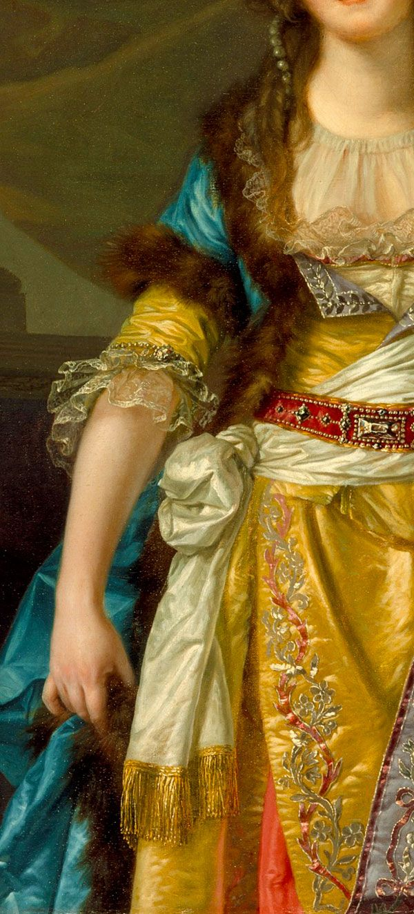 Detail Portrait of a Lady in Turkish Fancy Dress 1790, by Jean-Baptiste Greuze. Pearls threaded through hair, silk turban (not shown), fur lined and trimmed short sleeved turquoise silk over coat, gathered sheer fichu covering low cut decolletage of a yellow gold embroidered silk gown with tight elbow-length sleeves, lace ruffles to edge, lined with contrasting white silk, gold fringed burdash tied about waist, red leather and silver belt (no corset or panniers).: