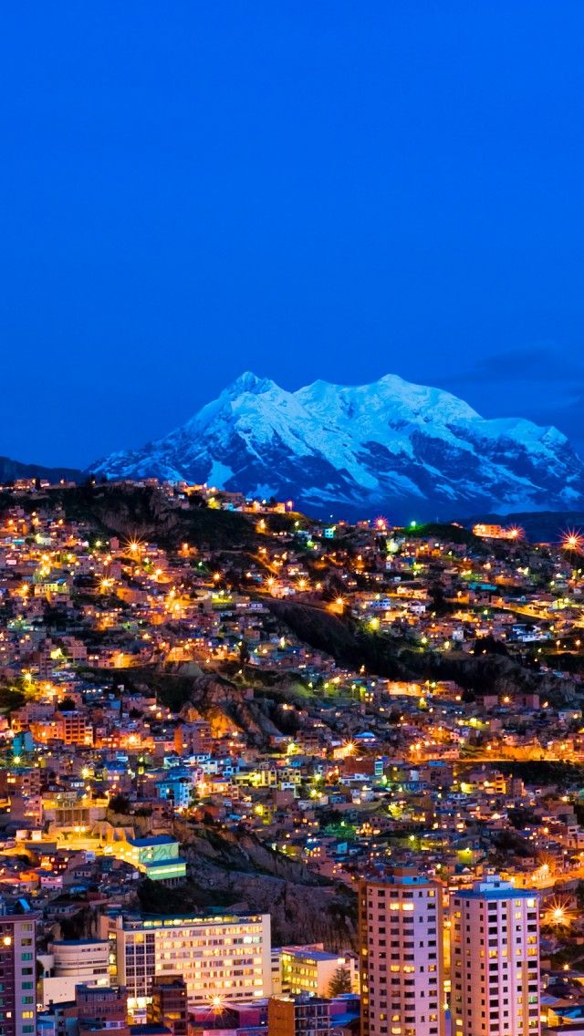 Stunning combination of mountainous background with the bustling city lights creates the unique view of La Paz, Bolivia
