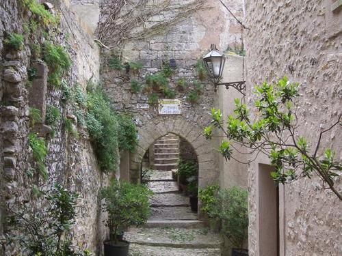 Street view up with arch, Erice