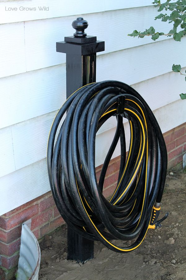 The 25 best garden hose holder ideas on pinterest for Garden hose idea