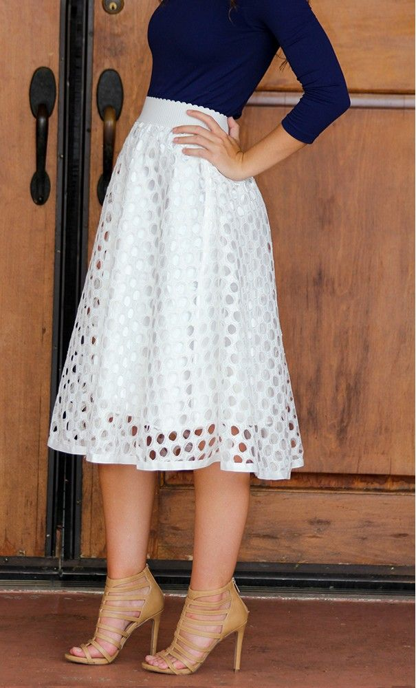 A fully lined crochet mid length skirt with punched crochet finish and full satin lining available in pink and black