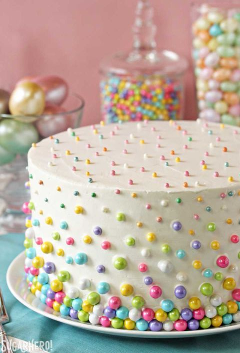Easter Polka Dot Cake: Stunning beyond measure, this polka dot cake will delight your family even more when they discover the mini colorful cake balls hidden inside. Click through to discover more easy decorating ideas for the best Easter cakes.