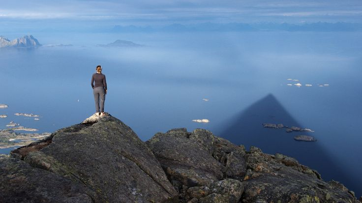 On top of the Lofoten Islands, looking at the shadow of the mountain in the sea. Photo: Kristin Folsland Olsen