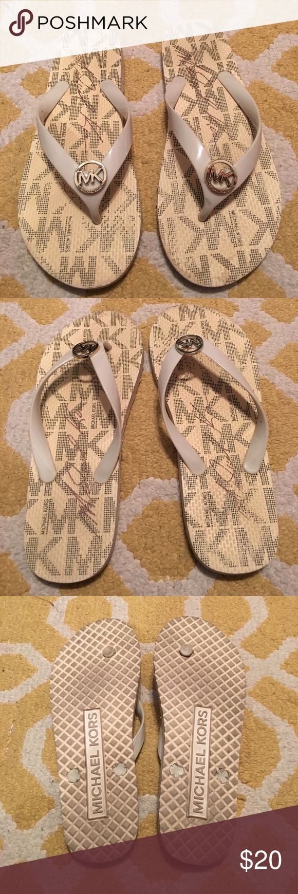 Michael Kors Cream Flip Flops size 7 Cream Michael Kors flip flops. Size 7. Gently used and show some signs of wear on the sides and top of flip flop as shown in pictures. Michael Kors Shoes Sandals