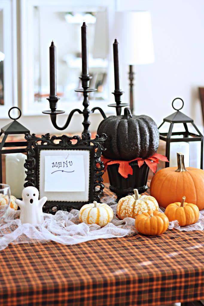 Halloween centerpiece (candles, lanterns, menu card, pumpkins)