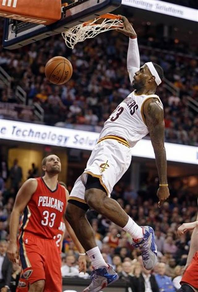 Cleveland Cavaliers' LeBron James dunks against the New Orleans Pelicans in the third quarter of an NBA basketball game Monday, Nov. 10, 2014, in Cleveland. James scored 32 points and added 12 rebounds and 10 assists to lead the Cavaliers to a 118-111 win.