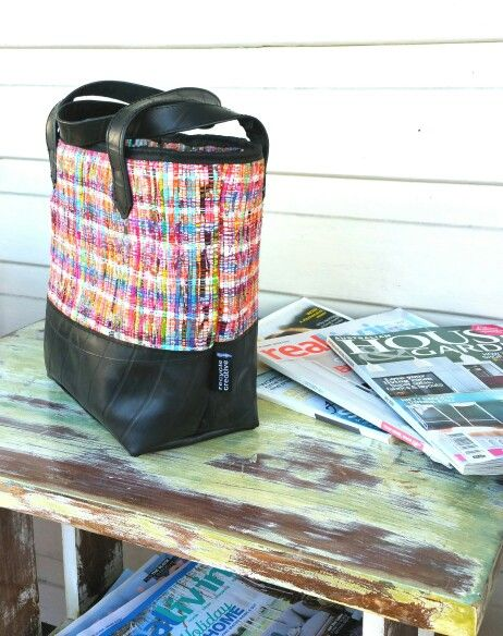 Upcycled mini tote combines truck  inner tube and hand-loomed garment  offcuts.
