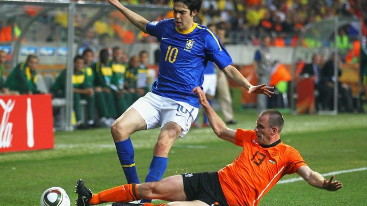 Andre Ooijer of the Netherlands tackles Kaka of Brazil during the 2010 FIFA World Cup South Africa Quarter Final match between Netherlands and Brazil at Nelson Mandela Bay Stadium on July 2, 2010 in Nelson Mandela Bay/Port Elizabeth, South Africa.