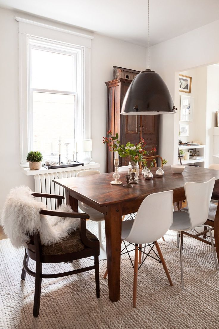 Double crank oval dining table at high fashion home industrial chic - A Bright Warm Well Lived Montreal Home