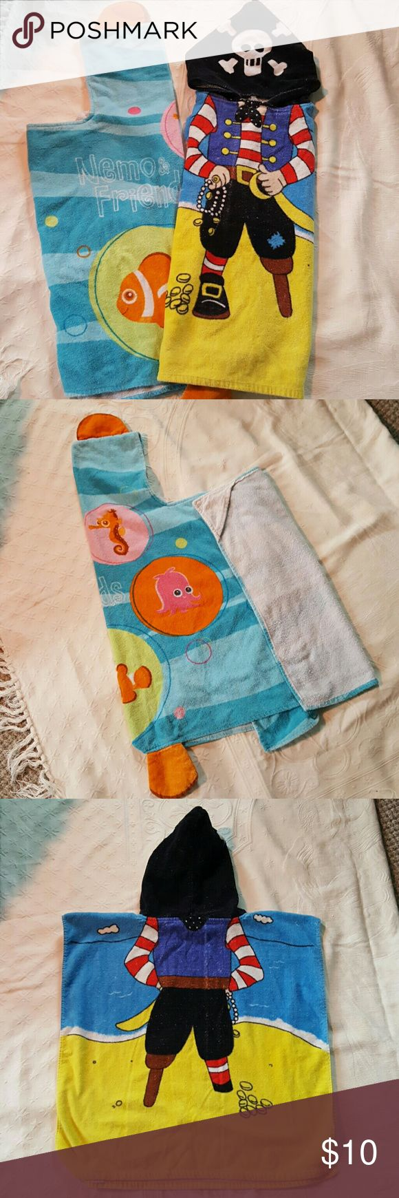BUNDLE!!Wearable kid's towels 2 super cute wearable towels. One is Poncho Style with a pirate. The other one is Nemo and Friends, has a hood and wraps around the body. Accessories