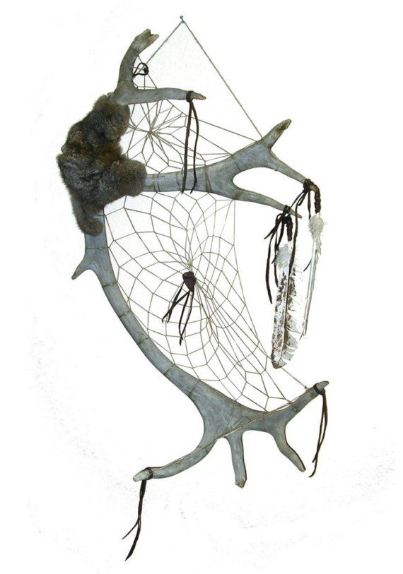 Caribou antler dream catcher. I would love to hang this on my bedroom wall!