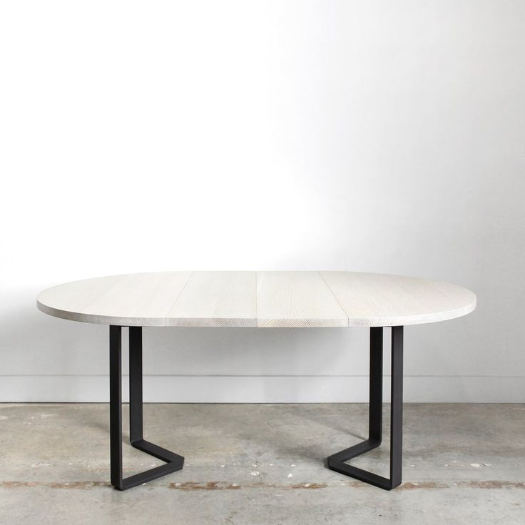 The Ferro Round Extension Table is our newest addition to the Ferro line. This expanding dining table features a solid wood top and a bent steel base, echoing the details of our Ferro Dining Table, bu