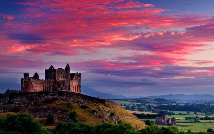 Rock of Cashel is one of the most iconic images of Ireland – a spectacular complex of medieval buildings upon a limestone outcropping in Tipperary's Golden Vale. The Rock of Cashel is steeped in mythology. Legend has it that it formed when St. Patrick banished Satan from a cave in Devil's Bit, the nearby mountain. Prior to the Norman Invasion of Ireland, it was the seat of the Kings of Munster. Most of the buildings that survive today date to the 12th and 13th centuries