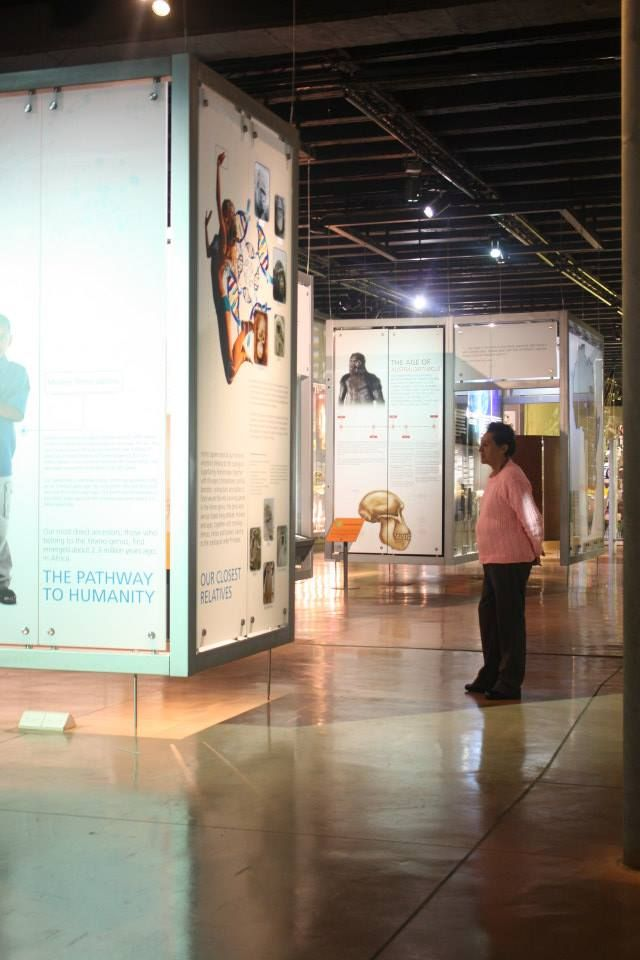 Walking through the Maropeng Visitor Centre exhibition in Gauteng, South Africa.